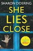 Cover-Bild zu She Lies Close (eBook) von Doering, Sharon