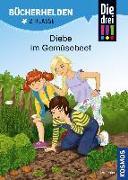 Cover-Bild zu Die drei !!!, Bücherhelden 2. Klasse, Diebe im Gemüsebeet von Ambach, Jule
