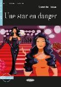 Cover-Bild zu Une Star en danger. Buch + Audio-CD von Hatuel, Domitille